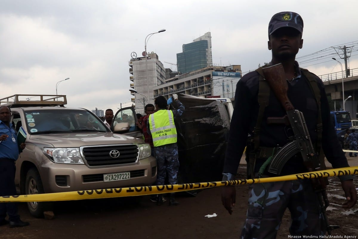 Ethiopian police arrive at the scene after the engineer in charge of Ethiopia's Grand Renaissance Dam was found dead in his car [Minasse Wondimu Hailu/Anadolu Agency]