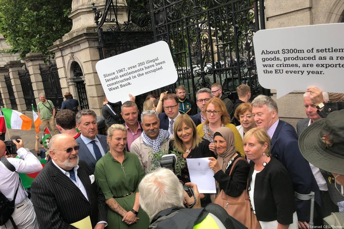 Irish Senator Frances Black (C) can be outside the Irish senate with supporters after a bill that would see the country boycott goods from illegal Israeli settlements was approved [Seanad CEG/Twitter]