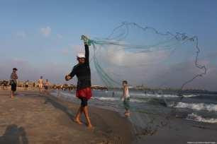 Palestinians enjoy their time at the sea coast of Gaza City [Mahmoud Ajour/Apaimages]