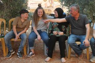 Palestinian teenager Ahed al-Tamimi (L-2) and her family hold an exclusive interview in Nabi Salih village of Ramallah, West Bank on 2 August, 2018 [İssam Rimawi/Anadolu Agency]