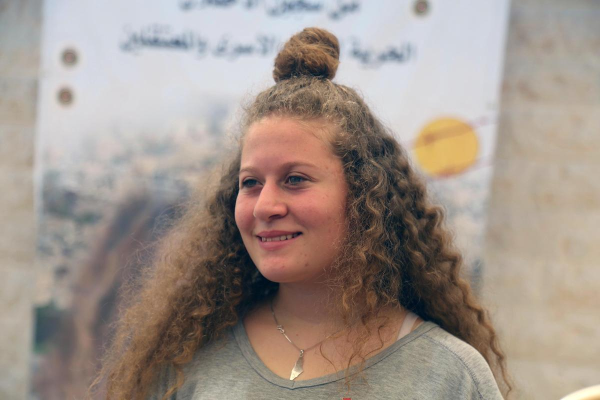 Palestinian teenager Ahed al-Tamimi (C) makes a speech during an exclusive interview in Nabi Salih village of Ramallah, West Bank on 2 August, 2018 [Ä°ssam Rimawi/Anadolu Agency]
