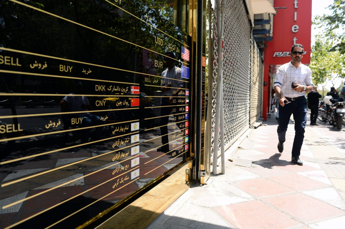 An exchange office is seen as toman devaluated to its lowest value against the US dollar [Fatemeh Bahrami/Anadolu Agency]