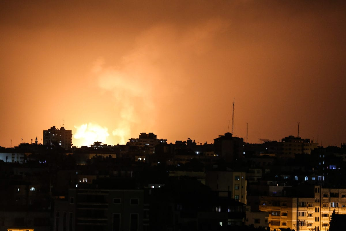 A fireball is seen exploding after Israeli army conducted airstrikes towards Beit Lahia, in northern of Gaza Strip on 9 August, 2018 [Mustafa Hassona/Anadolu Agency]