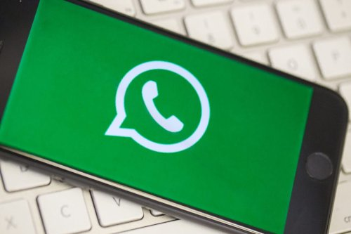 A phone screen displays the logo of WhatsApp [Ali Balıkçı/Anadolu Agency]