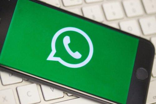 A phone screen displays the logo of WhatsApp [Ali Balıkçı/Anadolu Agency]