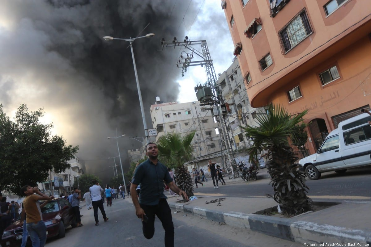 Israeli missiles destroy a cultural centre in the besieged Gaza Strip on 9 August 2018 [Mohammad Asad/Middle East Monitor]