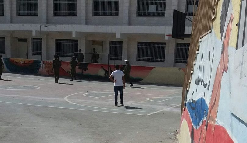 Israeli occupation forces storm a school in Bethlehem while students are sitting exams on 16 August 2018
