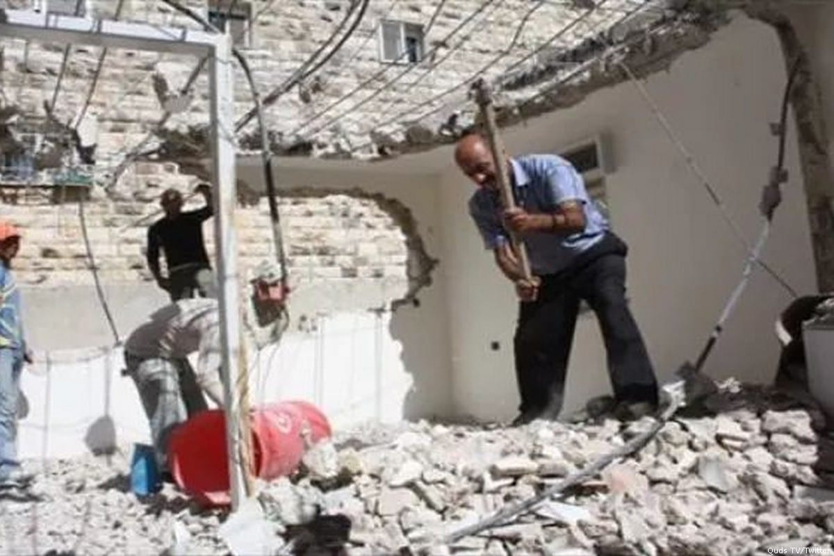 A Palestinian man can be seen demolishing his home on his wedding day after he was forced to do so by Israeli forces [Quds TV/Twitter]