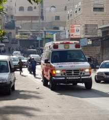 Ambulances are called after Israeli forces fired tear gas at a Palestinian school during a raid in Hebron, West Bank [Ma'an News Agency]