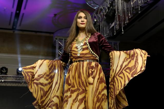 A model presents an outfit in the first Fashion Week at Divan Hotel in Erbil, Iraq on 4 September, 2018 [Yunus Keleş/Anadolu Agency]
