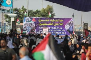 Palestinians stage a protest against US decision to cut funding to the United Nations Relief and Works Agency for Palestine Refugees in the Near East (UNRWA) in front of Beit Hanoun border gate in Gaza City, Gaza on 4 September, 2018 [Ali Jadallah/Anadolu Agency]
