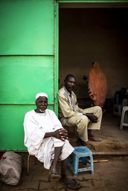 Sudanese tradesmen are seen in front of their shops in Khartoum, Sudan on 11 September, 2018 [Özge Elif Kızıl/Anadolu Agency]