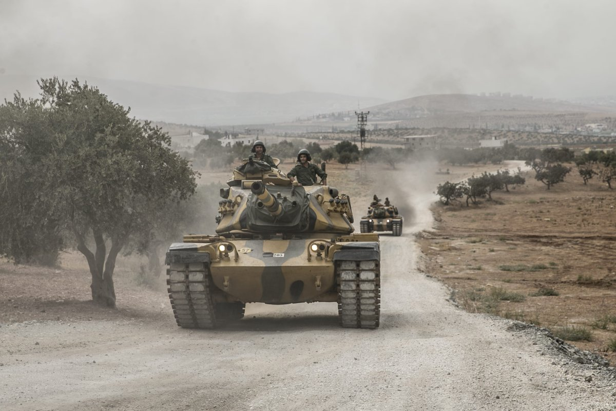 Tanks belonging to Turkish Armed Forces' are being dispatched to support the units at border in Reyhanli district of Hatay, Turkey on 13 September, 2018 [Cem Genco/Anadolu Agency]