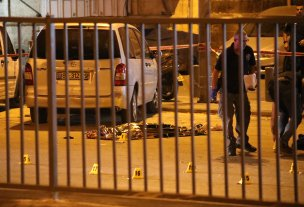 (Image depicts death) Body of a Palestinian lies on a road after being shot dead near Damascus Gate in Old City in East Jerusalem on September 18, 2018. Israeli police blocked the road for investigation. ( Mostafa Alkharouf - Anadolu Agency )