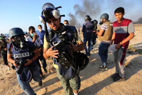 Palestinian journalists during the Great March of Return in Gaza Strip on 26 September, 2018 [Mahmoud Khattab/Apaimages]