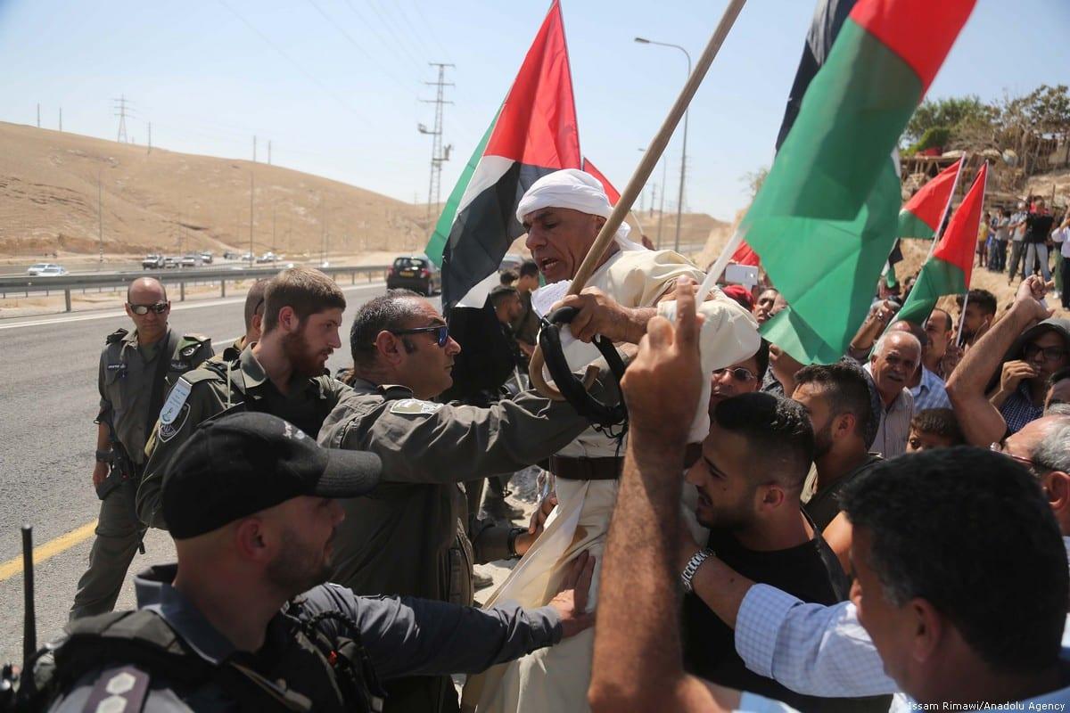 Israeli occupation forces storm the Bedouin village of Khan Al-Ahmar in the West Bank on 14 September 2018 [İssam Rimawi/Anadolu Agency]