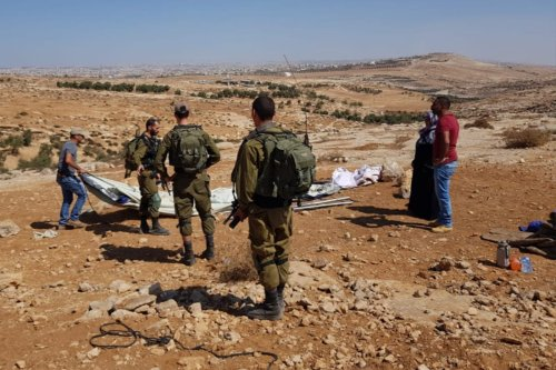 Israeli occupation forces dismantle a tent set up by Palestinian Yusuf Abu Aram's after his home was demolished in the village of Khirbet Qawasis, in the South Hebron Hills on 3 September 2018 [Twitter]