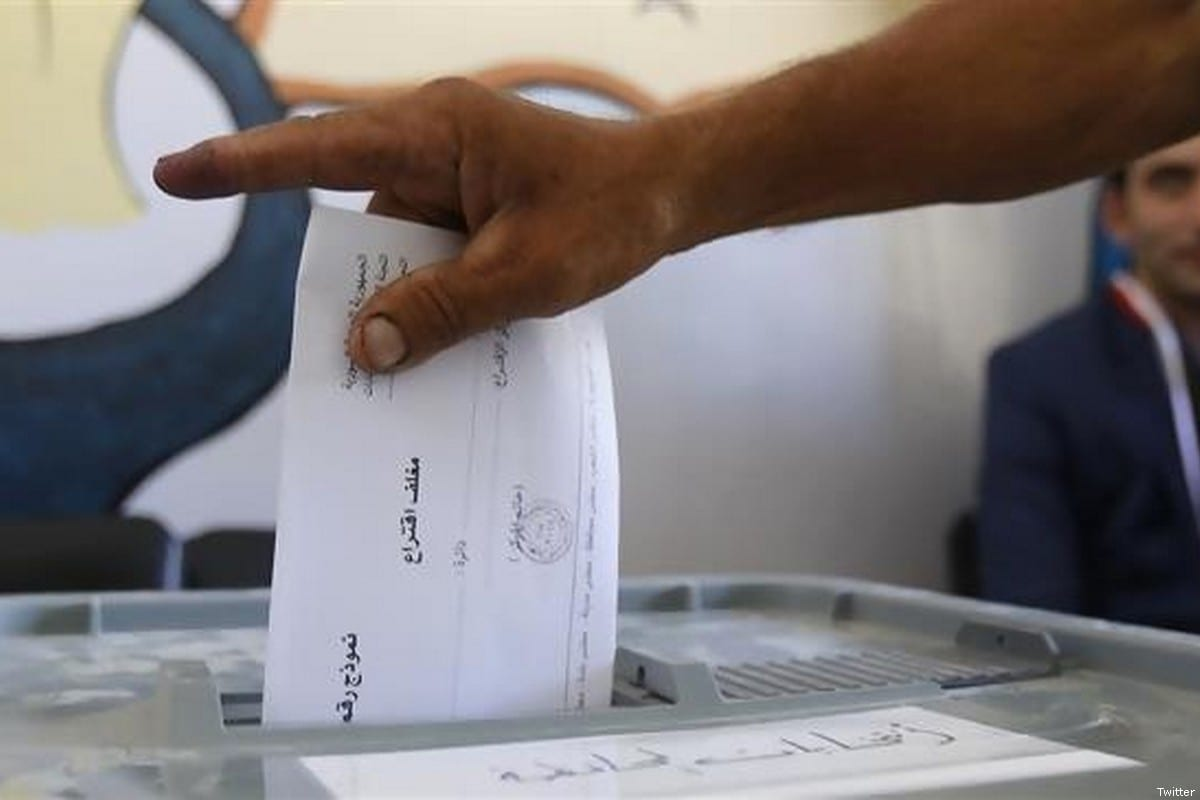 A Syrian voter puts his ballot in the box [Twitter]