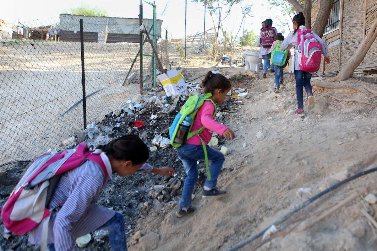 Palestinian Bedouin school children walk in the village of Khan al-Ahmar in the Israeli occupied West Bank on 16 September, 2018 [Shadi Hatem/Apaimages]