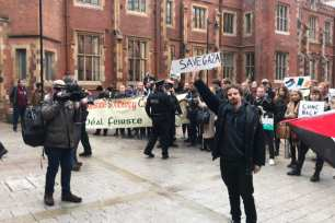 Students of the Queen's University in Belfast protesting Mark Regev's visit outside the law building [Twitter]