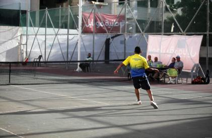 Palestinians play tennis doubles in Gaza City. 31 October, 2018 [Mahmoud Ajjour/Apaimages]