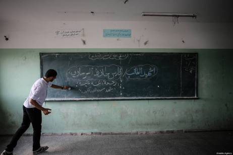 "Teacher of Faris Hafez al-Sarasawi, 12 years old Palestinian child who was killed by Israeli forces in ""Great March of Return"" demonstrations, writes his name on the board during a remembering by his classmates and teacher at Muaz bin Jabal Elementary School in Shuja'iyya neighborhood of Gaza City, Gaza on October 06, 2018 [Ali Jadallah / Anadolu Agency]"