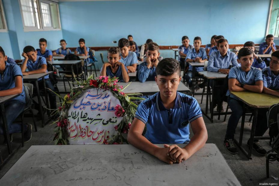 "A wreath lays on the seat of Faris Hafez al-Sarasawi, 12 years old Palestinian child who was killed by Israeli forces in ""Great March of Return"" demonstrations, during a remembering by his classmates and teacher at Muaz bin Jabal Elementary School in Shuja'iyya neighborhood of Gaza City, Gaza on October 06, 2018 [Ali Jadallah / Anadolu Agency]"