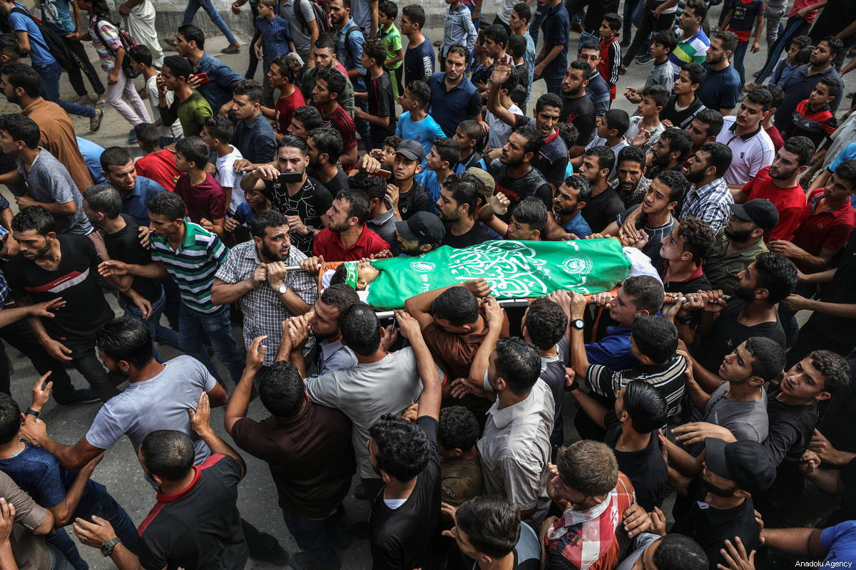 "Palestinians carry the dead body of Faris Hafez al-Sarasawi, 12 years old Palestinian child who was killed by Israeli forces in ""Great March of Return"" demonstrations, during his funeral ceremony in Shuja'iyya neighborhood of Gaza City, Gaza on October 06, 2018 [Ali Jadallah / Anadolu Agency]"