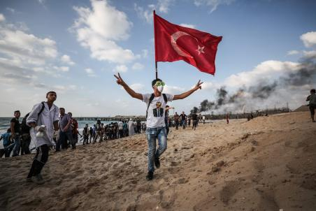 """GAZA CITY, GAZA - OCTOBER 8: Palestinians gather to support the """"maritime demonstration"""" to break the Gaza blockade by sea with more than 20 vessels of various sizes in Gaza City, Gaza on October 8, 2018. ( Mustafa Hassona - Anadolu Agency )"""