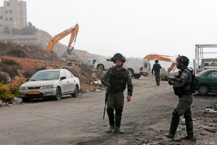 Israeli forces can be seen at a demolition site on 10 October 2018 [Wafa]