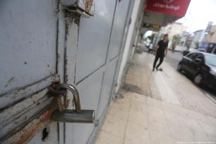 Closed shops are seen during a general strike in Gaza protesting Israel's Nation State law on 1 October 2018 [Mohammed Asad/Middle East Monitor]