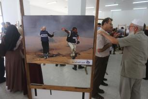 Photo exhibition highlights Israel's violations against journalists in Gaza [Mohammed Asad/Middle East Monitor]