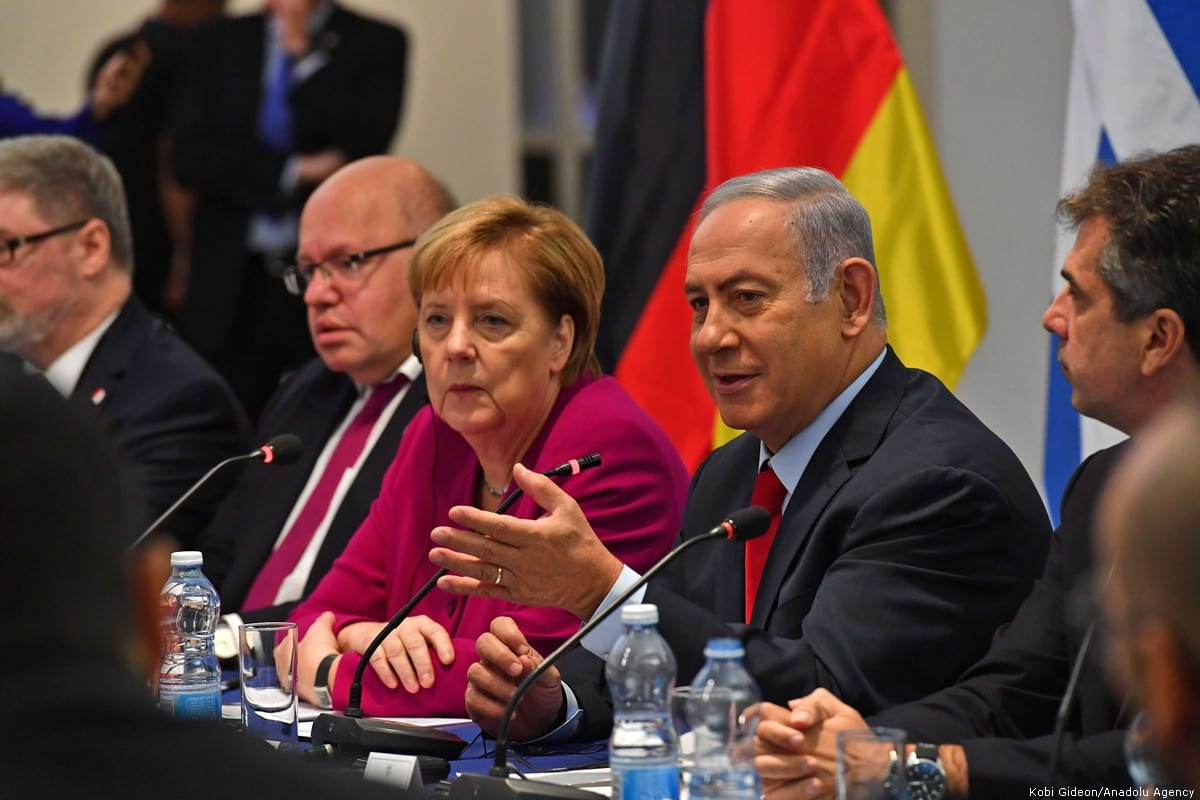 Israeli Prime Minister Benjamin Netanyahu (R2) and German Chancellor Angela Merkel (R3) meet with German and Israeli businessmen in Jerusalem on 4 October 2018 [Kobi Gideon/Anadolu Agency]