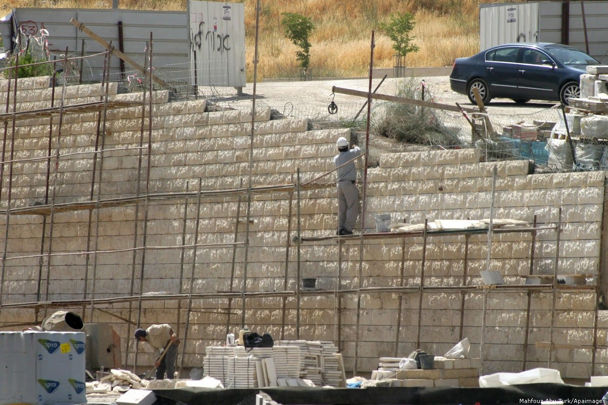 Workers can be seen at a construction site in Jerusalem 10 June 2012 [Mahfouz Abu Turk/Apaimages]