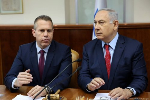 Israeli Prime Minister Benjamin Netanyahu (R) sits next to Israeli Public security Minister Gilad Erdan during the weekly cabinet meeting at his Jerusalem's office on April 10, 2016. / AFP / POOL / GALI TIBBON (Photo credit should read GALI TIBBON/AFP/Getty Images)