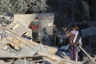A group of Palestinian boys look on at the destruction caused by Israel's airstrike on Gaza last night. November 2018 [Mohammed Asad/Middle East Monitor]