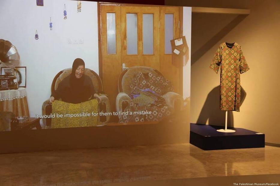 """Rajaa Alzeer speaks on her work, 28 July 2018 at """"Labour of Love"""" exhibition at the Palestinian Museum. [The Palestinian Museum/Facebook]"""