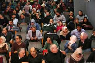 Seen here are Palestinians waiting for a film to start at the 4th Annual Red Carpet festival in Gaza City, 26 November 2018 [Ashraf Amra/Apaimages]
