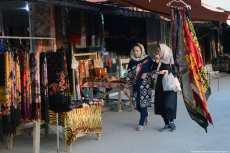 Two women look at the homemade carpets and decide what to buy Iran, 21 November 2018 [Fatemeh Bahrami/Anadolu Agency]