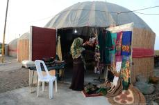 A merchant adjusts her display, ready for customers at the Turkmen bazaar Iran, 21 November 2018 [Fatemeh Bahrami/Anadolu Agency]