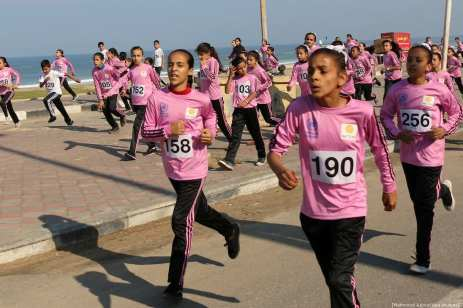 Palestinian students take part in a race marking the International Day of Dignity, in Gaza city, on November 7, 2018. Photo by Mahmoud Ajjour