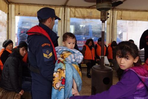 Irregular migrants are brought to Ayvalik Coast Guard Command in Balikesir's Cunda island after rescued by members of Turkish Coast Guard Command on 19 November, 2018 in Balikesir, Turkey [Hakan Firik/Anadolu Agency]