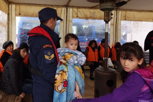 Irregular migrants are brought to Ayvalik Coast Guard Command in Balikesir's Cunda island after rescued by members of Turkish Coast Guard Command on 19 November, 2018 in Balikesir, Turkey [Hakan Firik/Anadolu Agency]