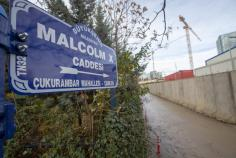 Ankara Metropolitan Municipality workers change the road sign to 'Malcolm X Avenue' where the new US embassy is being built in Ankara, Turkey on November 29, 2018. ( Aytaç Ünal - Anadolu Agency )