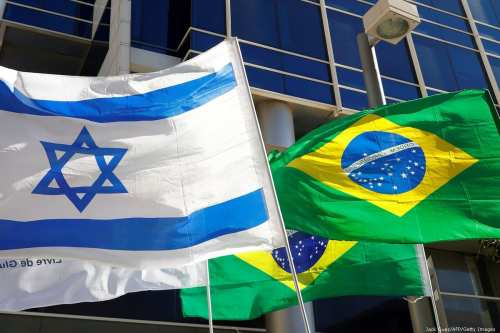 The Israeli and Brazilian flags hang outside the Brazilian Embassy, in Tel Aviv on 28 October 2018 [Jack Guez/AFP/Getty Images]