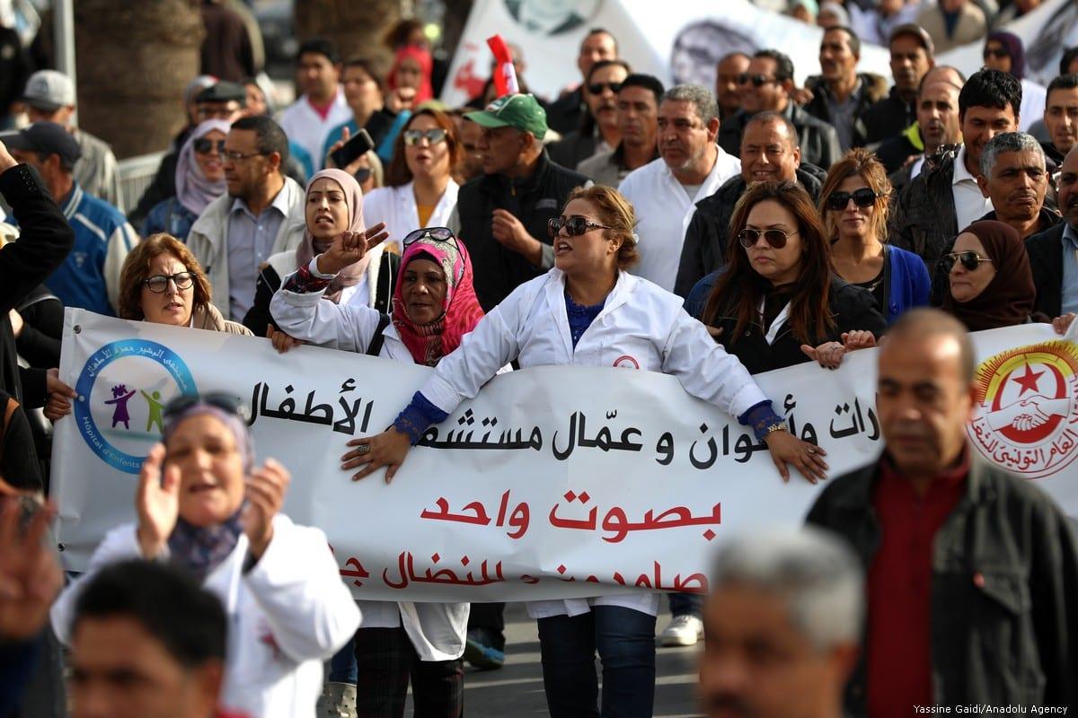 Tunisian civil servants and workers protest for wage increase in Tunis, Tunisia on 22 November 2018 [Yassine Gaidi/Anadolu Agency]