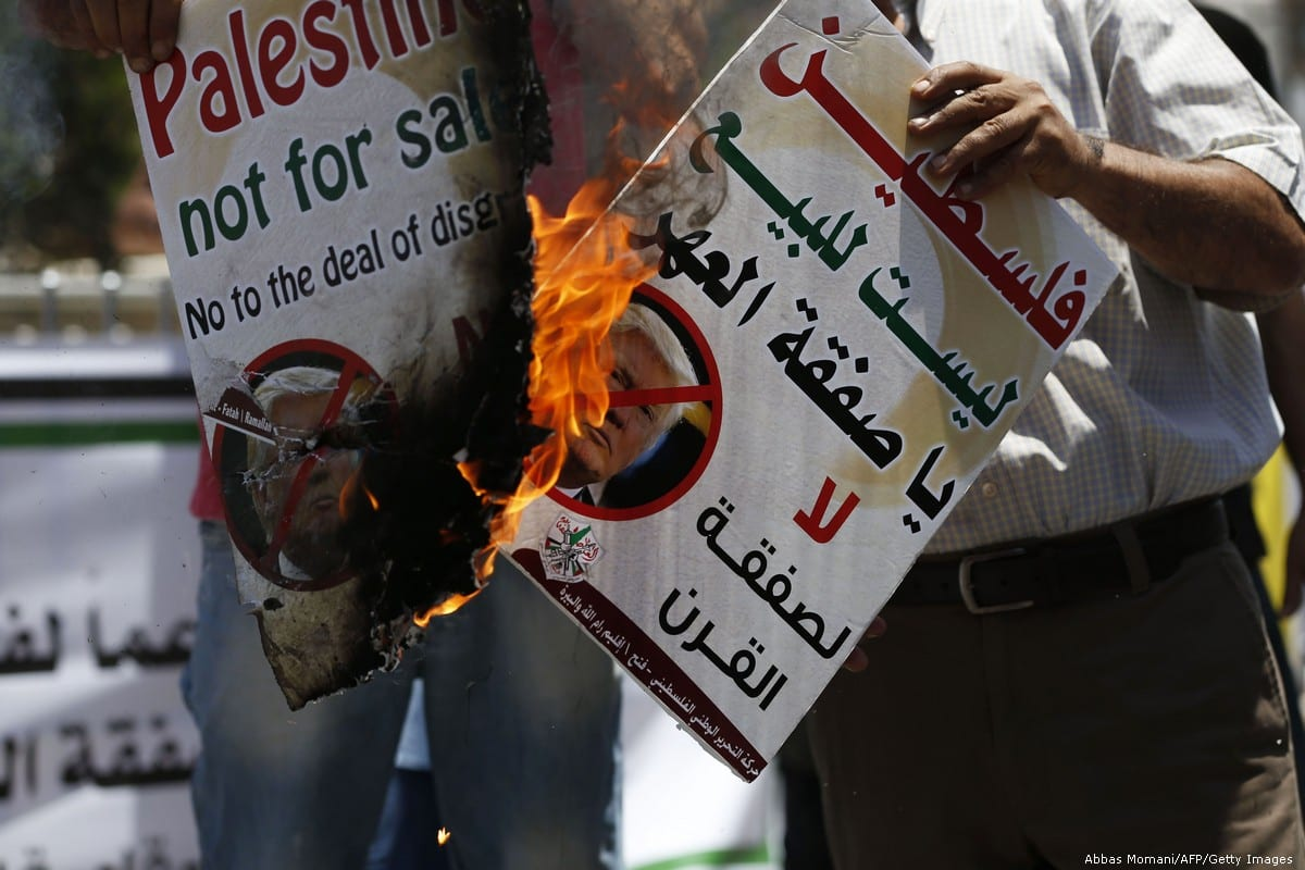 Palestinians protest against the Trump's deal of century plan in the West Bank city of Ramallah on 2 July 2018 [Abbas Momani/AFP/Getty Images]