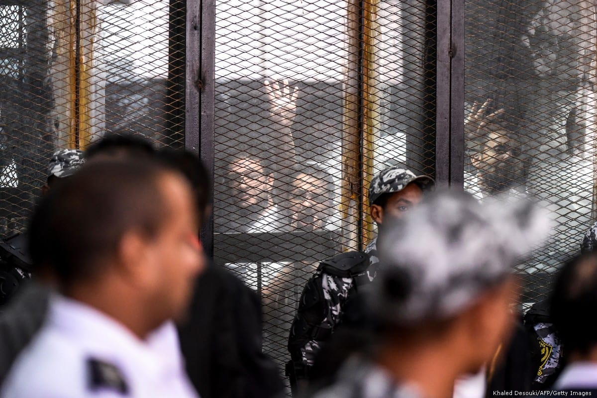 Prisoners are seen during a court case in Cairo on 28 July 2018 [KHALED DESOUKI/AFP/Getty Images]