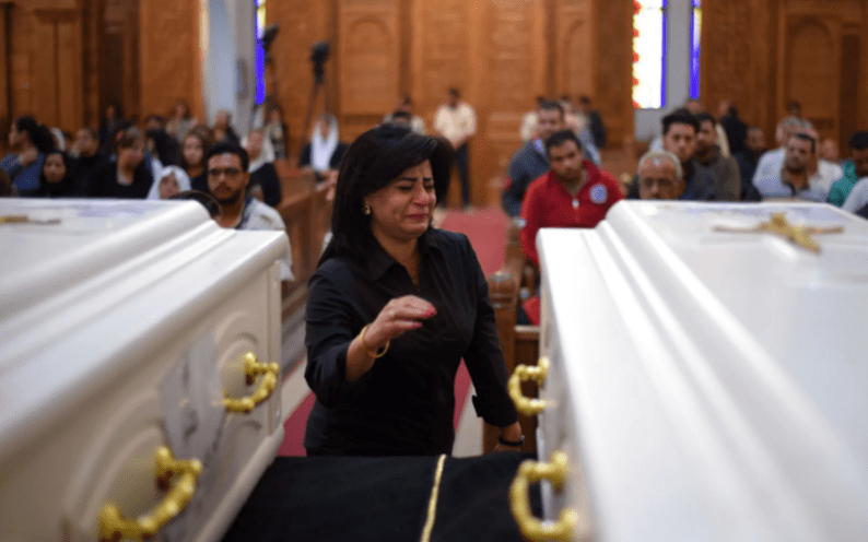 A Coptic Christian woman mourns victims killed in an attack on 2 November, 2018 [Mohamed El-Shahed/Getty Images]