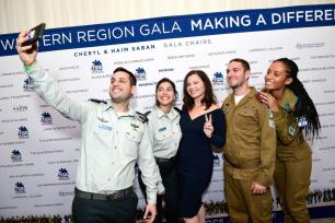 Fran Drescher and IDF soldiers attend Friends of The Israel Defense Forces (FIDF) Western Region Gala at The Beverly Hilton Hotel on 1 November, 2018 in Beverly Hills, California [Shahar Azran/Getty Images]